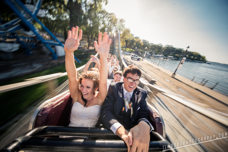 Okoboji Arnolds Park roller coaster Iowa MInnesota Theme Park wedding party bride groom west lake Iowa Wedding photography Photographer Photos pro professoinal