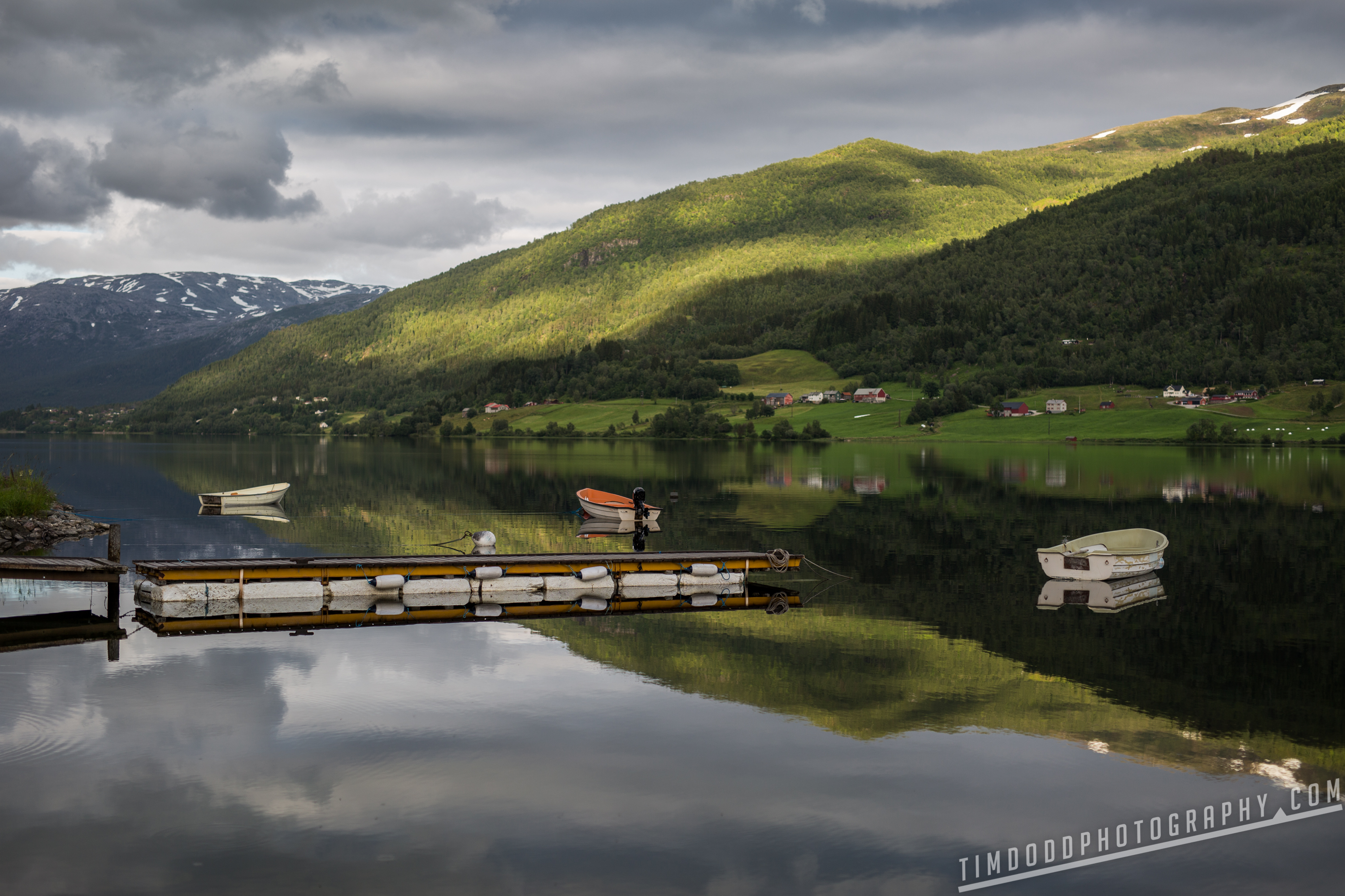 """Voss Norway mirror lake reflection boat beautiful mountains 60°47'31"""" N 6°34'28"""" E 1-1000 sec at f - 2.0 ISO 100 Canon EOS 5D Mark III Sigma 50mm F1.4 Art by Tim Dodd Photography"""